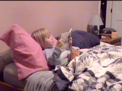 Amy reading her bedtime book